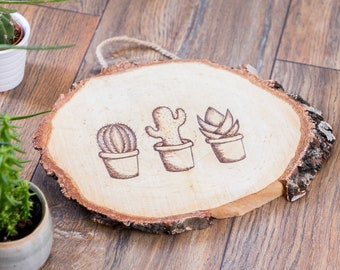Wooden trunk disk with burned cacti