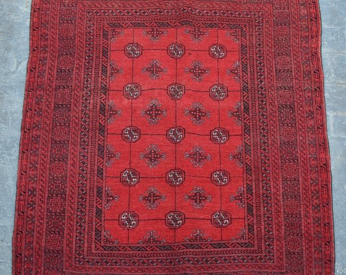 Vintage Afghan tribal Bokhara rug
