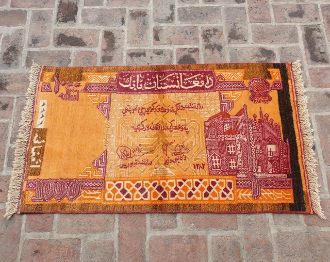 Hand knotted Wool Afghan Currency Rug