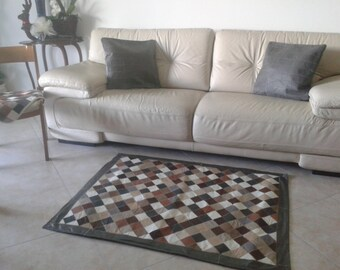 tappeto patchwork in vera pelle.