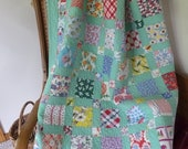 Vintage Feedsack Kit Green background with 48 different vintage feedsack squares Pattern included.
