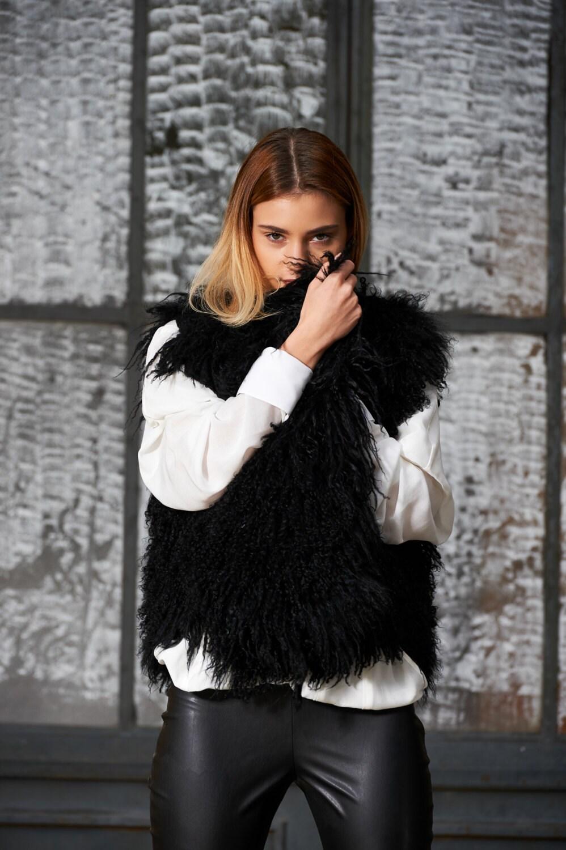 gilet noir manteau veste en fourrure manteau sans manches. Black Bedroom Furniture Sets. Home Design Ideas