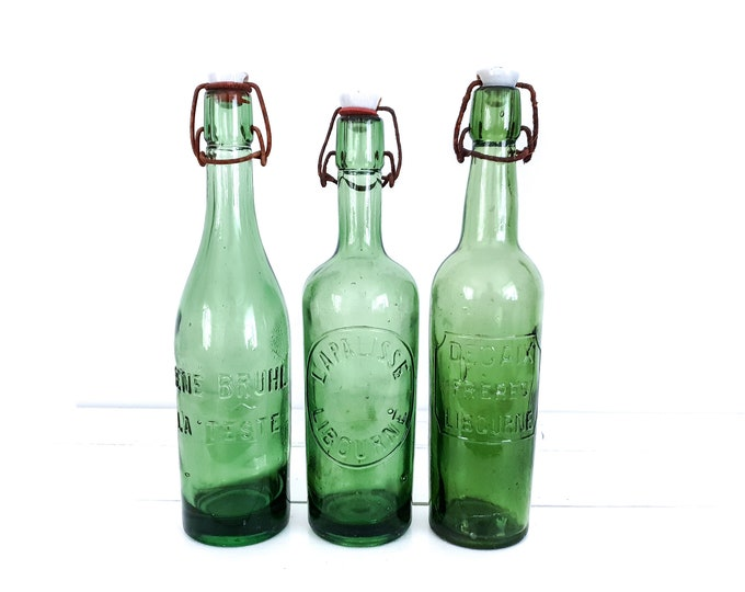 Vintage green bottles with clip closure • antique green bottles with porcelain cap • French farmhouse style decor • old glass bottles
