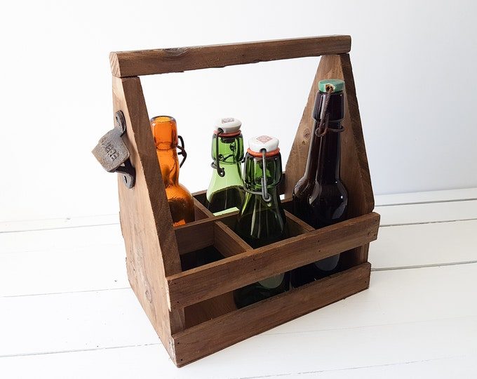 Old wooden bottle crate with opener
