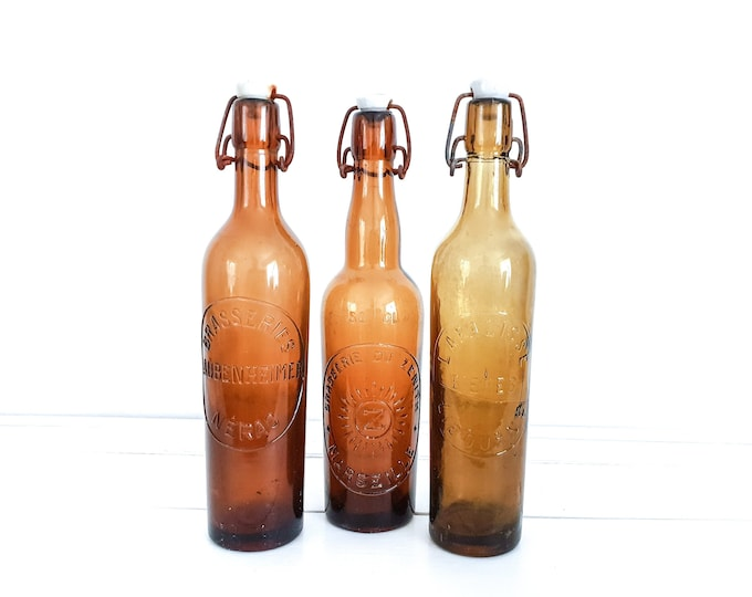 Old brown beer bottles with clip closure • beer bottles with porcelain cap • rustic country-style French decoration • old glass bottles