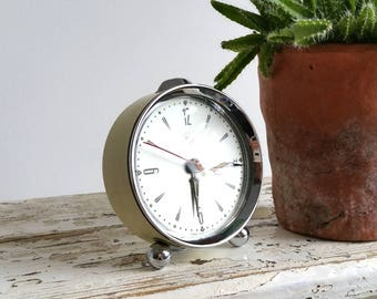 Old alarm clock off white