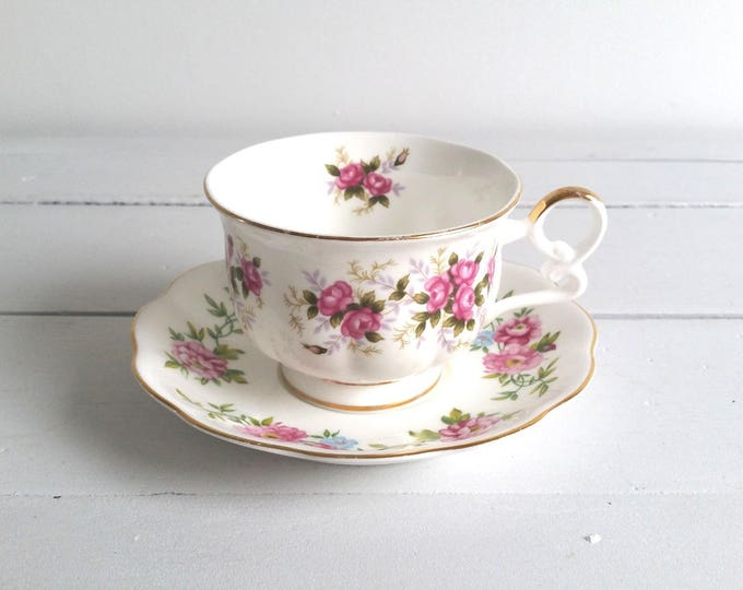 Mismatched cup and saucer 'pink flowers'