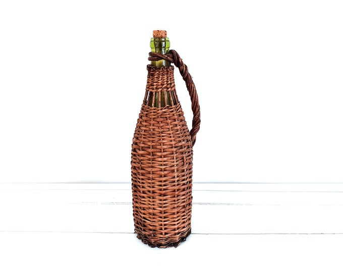 Vintage green glass bottle inside wicker • old bottle in basket • French country farm decor • hand knotted wrapped bottle • retro glass vase