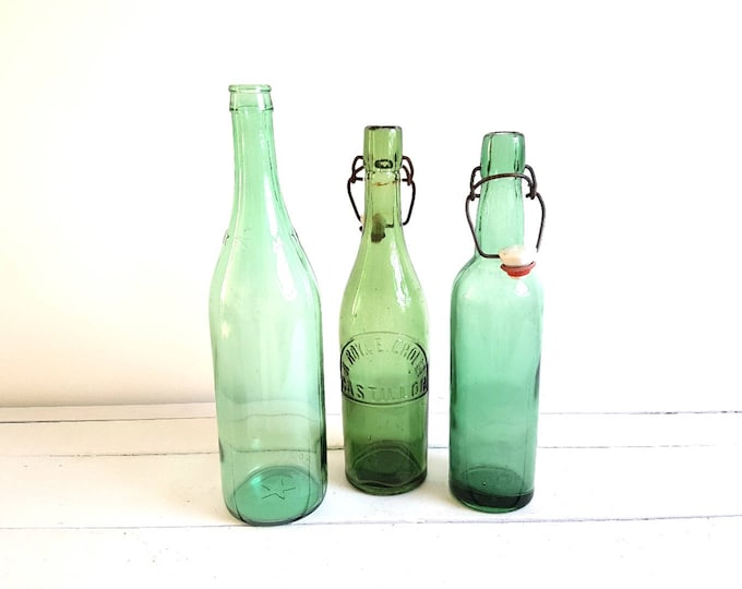 Vintage French green glass bottle