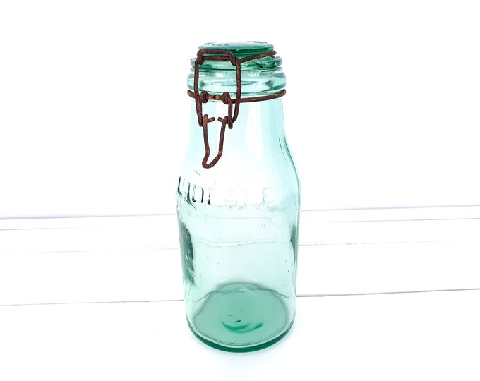 Vintage green glass L'Ideal preserving bottle with clip closure • French preserving jar • glass storage jar with lid • green glassware