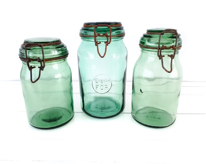 Vintage French glass preserving jar metal clip closure • preserving bottle • glass storage jar with lid • green glassware • kitchen accents