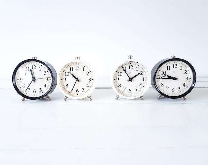 Vintage set alarm clocks black and white Hema • white farmhouse clocks • vintage lot decoration clocks