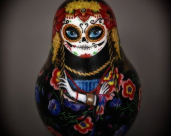 Kuzma's mother roly-poly hand painted doll, makes a haunted metal sound when in motion