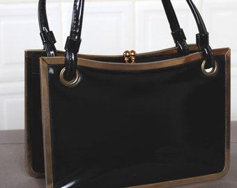 c723449cd90 1960s Irish handbag in black patent leather with brass frame