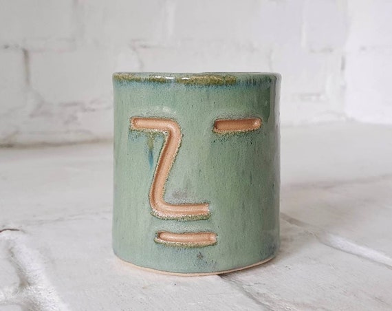 Face vessel, green marble glaze stoneware clay, collaboration with Joe Taylor illustration