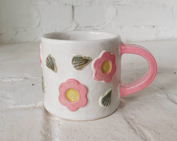 SLIGHT SECONDS Daisy ceramic mug, relief pattern with white glaze, high fired speckled stoneware clay