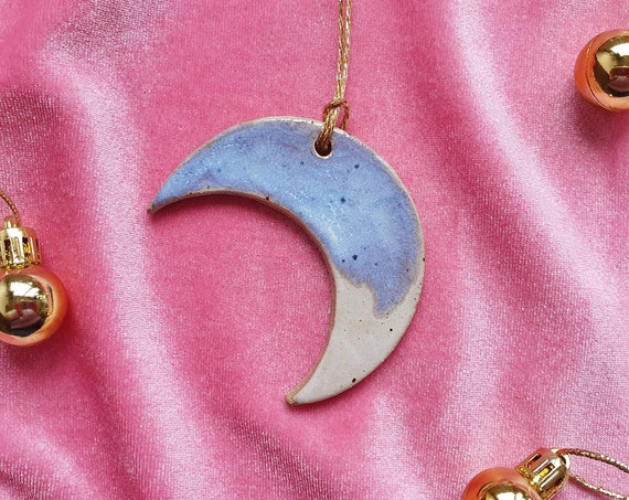 Hanging moon decoration,  blue and white glaze