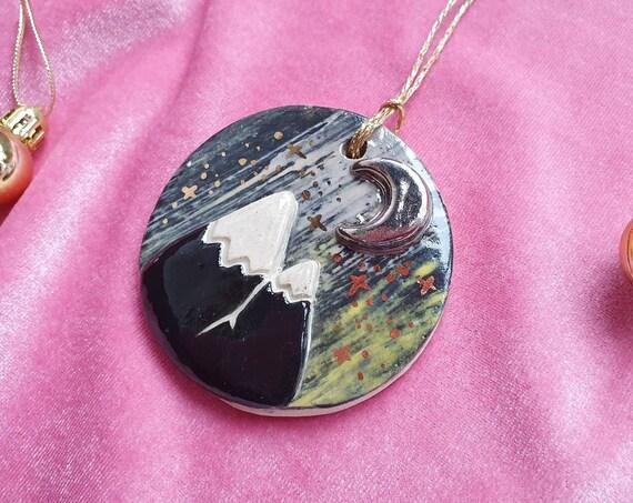 mountain scene hanging decoration, platinum lustre moon,  gold stars