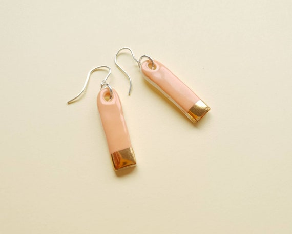 Mini orange gold edge dangles, ceramic with sterling silver posts