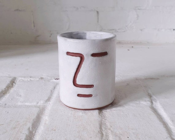 Face vessel, white glaze red clay, collaboration with Joe Taylor illustration