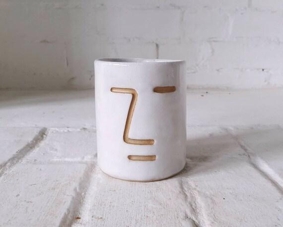 Face vessel, white glaze stoneware clay, collaboration with Joe Taylor illustration