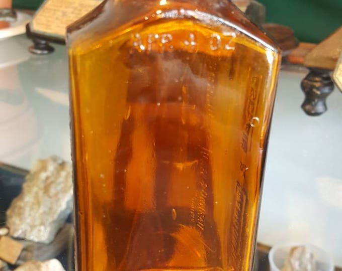 Casgraim and Charbonneau vintage pharmaceutical amber bottle