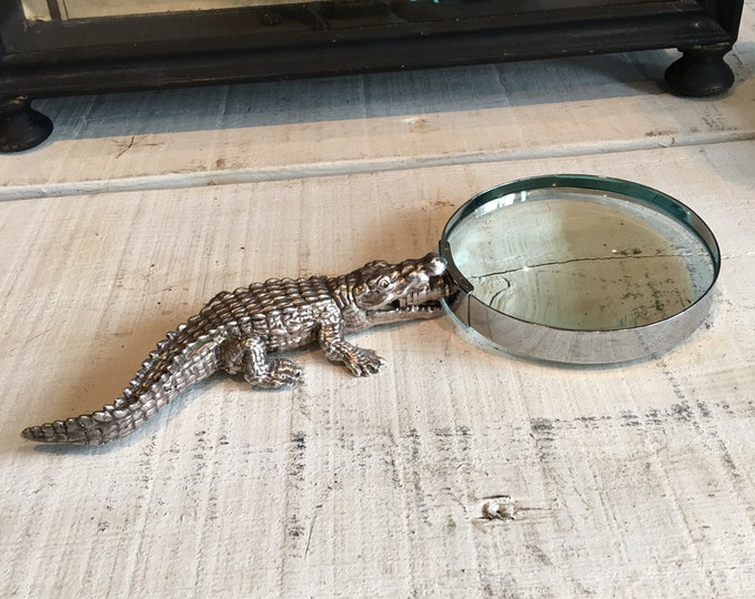 Vintage magnifying glass with crocodile