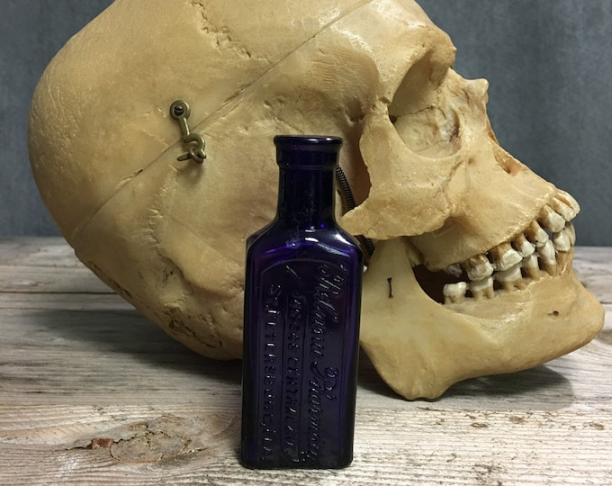 Antique purple cork top bottle Reliance Pharmacy