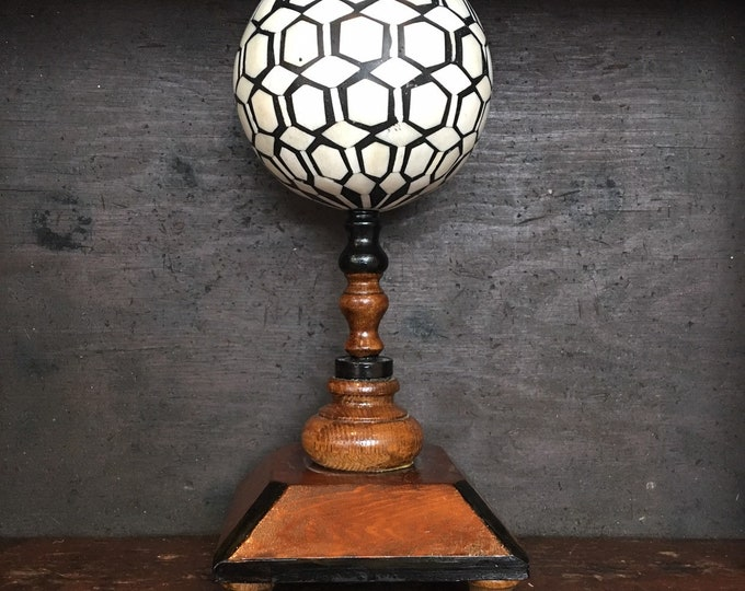 Big bone ball on wood stand, museum style