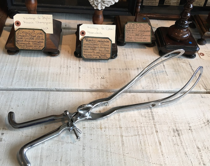 Vintage forceps medical instrument obstetric gynecology