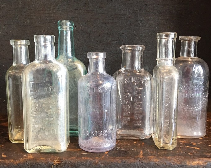 Lot of 7 antique cork top glass bottle purple white blue