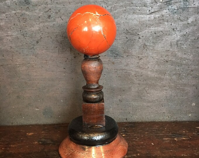 Jaspe ball on wood stand, antique museum style