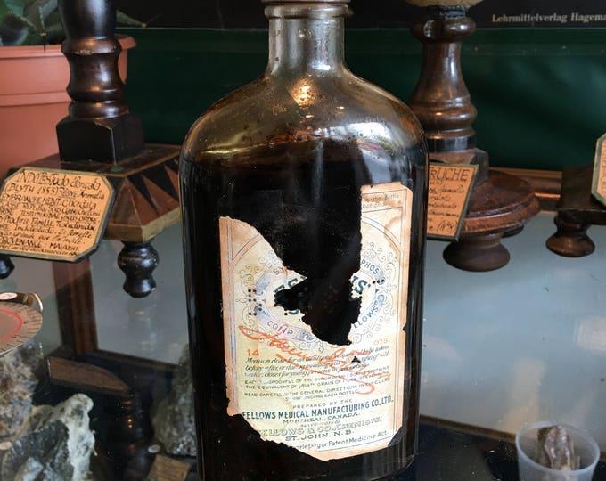 Antique syrup with content bottle glass bottle. Vintage antique medicine