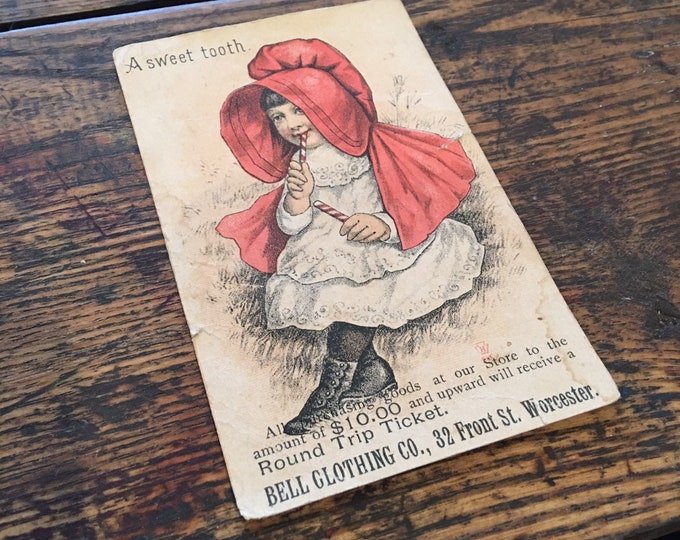 Antique 1880 Bell clothing advertising card litle girl A sweet tooth