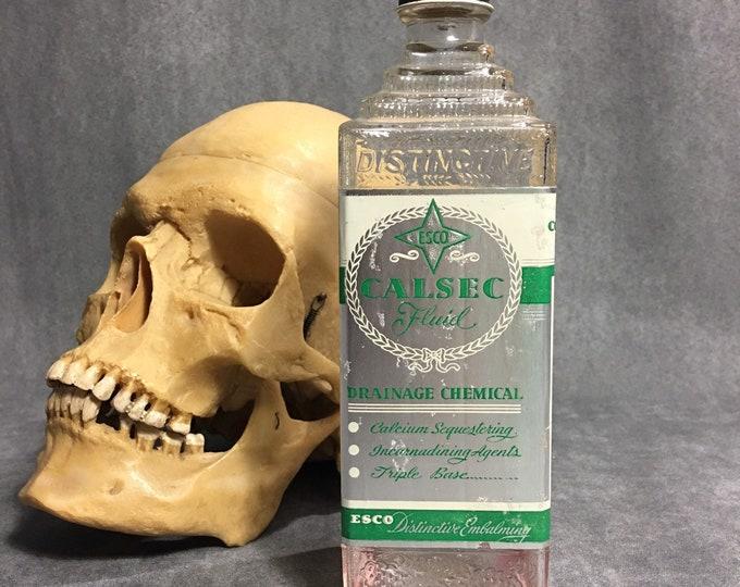 Antique 1940s embalming Esco bottle