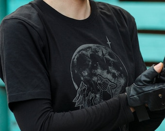 Available in L, XL, XXL. Organic Cotton T-Shirt with Reflective Wolves Against Wolf Whistling