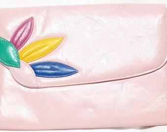Pink handbag with shoulder strap
