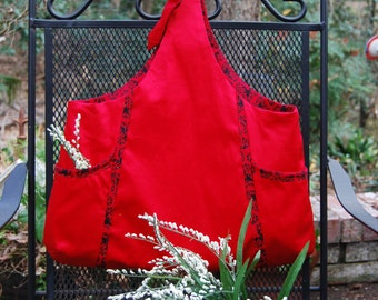 Red denim bag with contrasting trim and lining