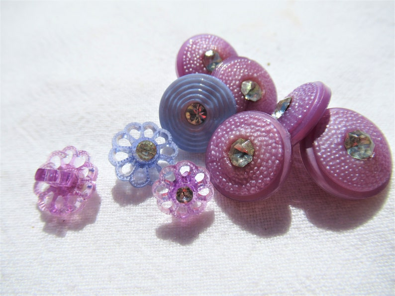 58 slight dome top Blue flowers with rhinestones Purple and Blue buttons with rhinestone center Purple flower with rhinestone center