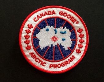canada goose logo on left arm