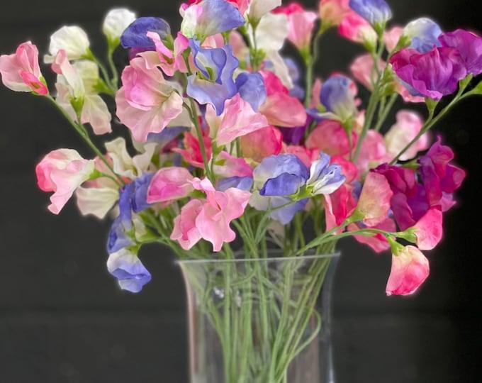 Sweet peas faux floral arrangement set into a glass vase