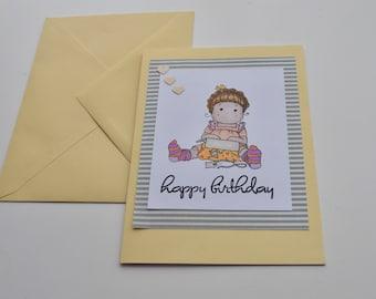 Handmade stamped and hand coloured Magnolia tilda Birthday Card, sitting opening birthday present