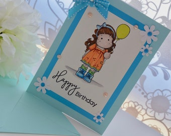 Blue handmade, hand stamped, hand coloured birthday card with Magnolia Tilda image with balloon
