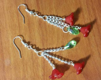 Red flower with a green Swarovski teardrop long dangle earring.