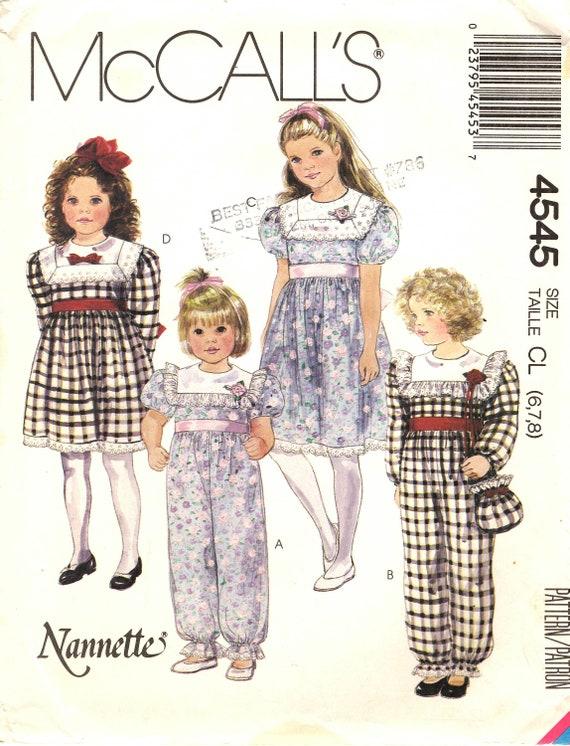 McCall 4545 Mädchen Overall elastische Beine, Kleid mit kontrastkragen, Zurück Taste Mieder, versammelt Rock, Puffärmeln und Tasche Größe 6, 7, 8
