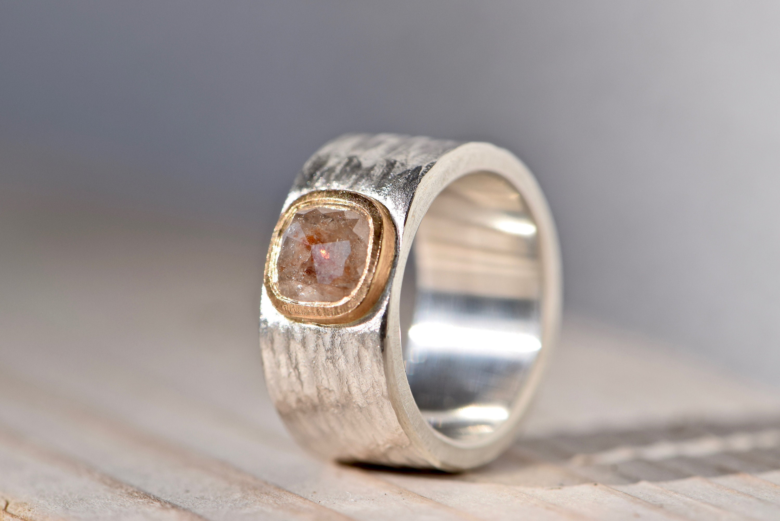 Wide hammered silver ring with diamond