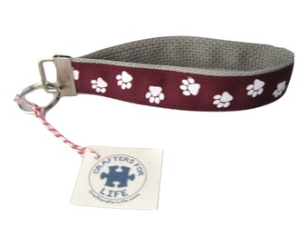 White Paw Print on Maroon Key Chain with Silver Backing