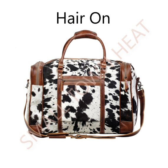 Myra Bags Hair On Bags Weekender Bags Overnight Bags Cow Etsy Use it as a carry on bag on flights, or throw in some clothes for a weekend the top closes with a zipper, and a snap on tab. myra bags hair on bags weekender bags overnight bags cow print bags multi print bags multi hide bags