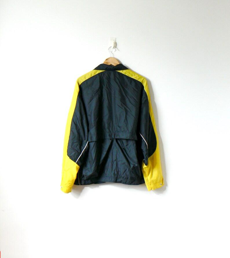 4b11e56b83 90s Nike Yellow   Black Windbreaker Vintage Nike Windbreaker