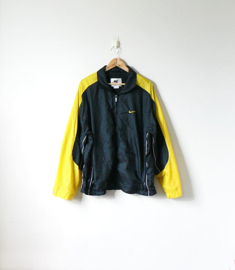 8a683233f0a1 90s Nike Yellow   Black Windbreaker Vintage Nike Windbreaker